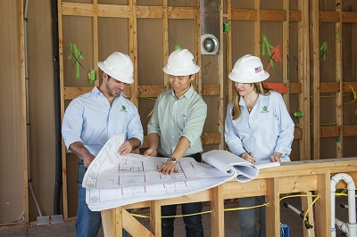 Green building consultants meet with the building team to review documentation and progress. © Tommie Huffman.
