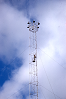 Worker near top of moonlight tower