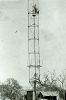 Worker on top of moonlight tower
